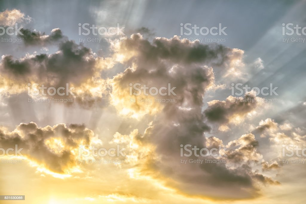 colorful dramatic sky with clouds and sunbeams at sunset. stock photo