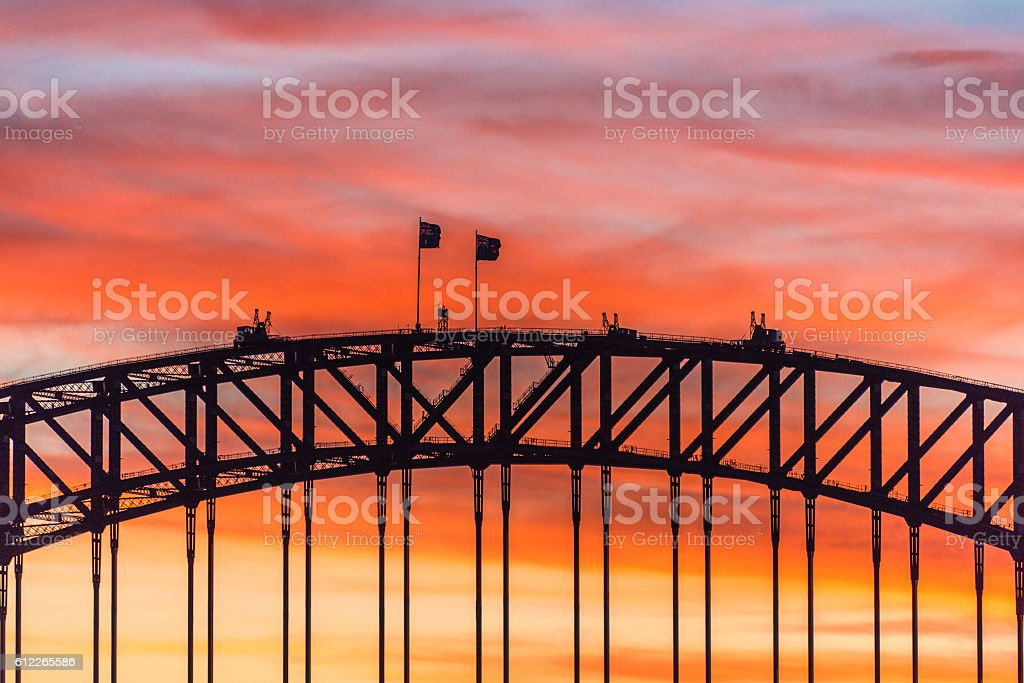 Colorful dramatic sky with silhouette of Sydney Harbour Bridge stock photo