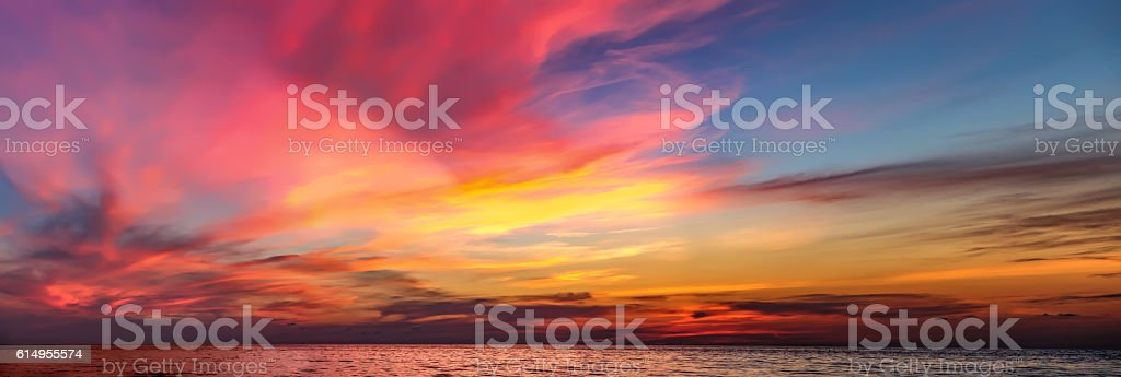 Colorful dramatic sunset with cloudy sky . stock photo