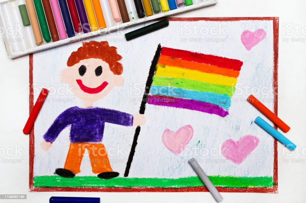 Happy gay couple with lgbt flag