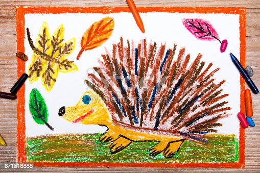 istock Colorful drawing - happy hedgehog and autumn leaves 671818888
