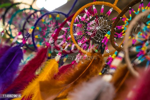 Colorful handmade dream catchers with feathers threads and beads hanging