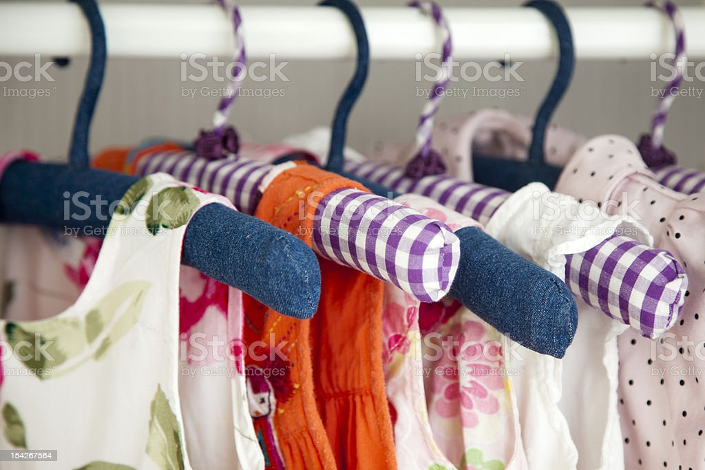 Colorful dresses hanging in wardrobe stock photo