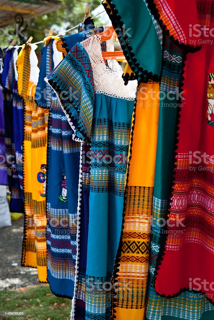 Colorful dresses on a rope line royalty-free stock photo