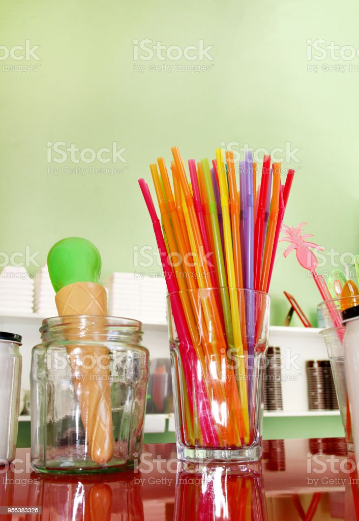 Colorful Drinking Straws In Glass Plastic Spoon And Plastic