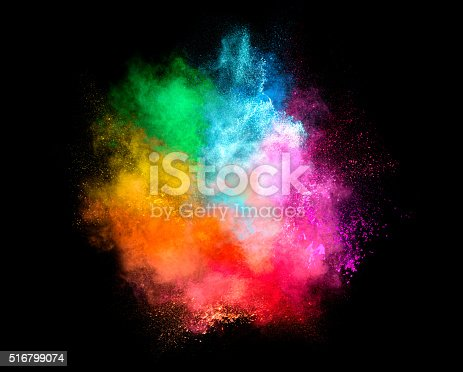 516947346istockphoto Colorful Dust Particle Explosion Isolated on Black Background 516799074