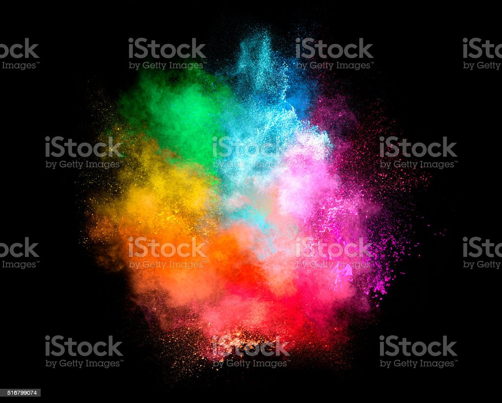 Colorful Dust Particle Explosion Isolated on Black Background stock photo