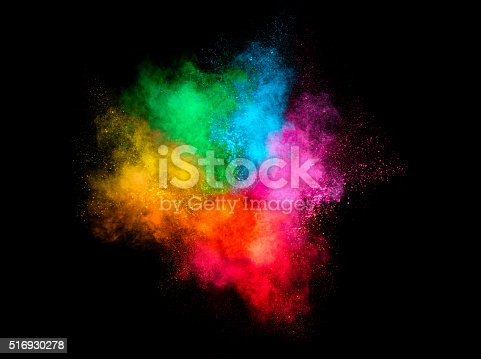 516947346istockphoto Colorful Dust Particle Explosion Isolated on Black Background 516930278