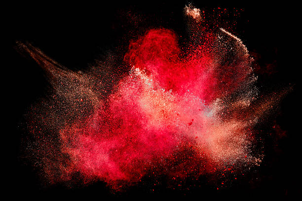 Colorful Dust Particle Explosion Isolated on Black Colorful dust particle explosion resembling blood or a pyrotechnic effect over black. Closeup of a color explosion isolated on black powder snow stock pictures, royalty-free photos & images