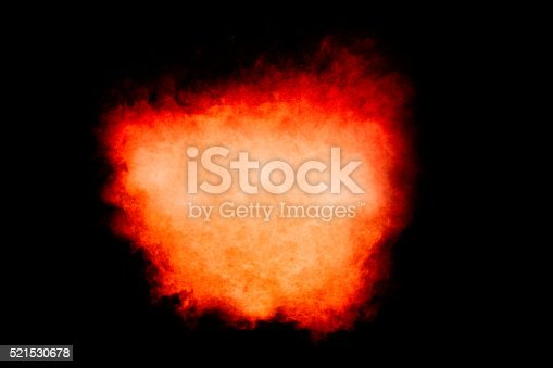 516947346istockphoto Colorful Dust Particle Explosion Isolated on Black 521530678