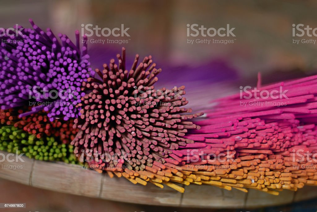 Colorful dyed aroma incense sticks made in Thailand stock photo