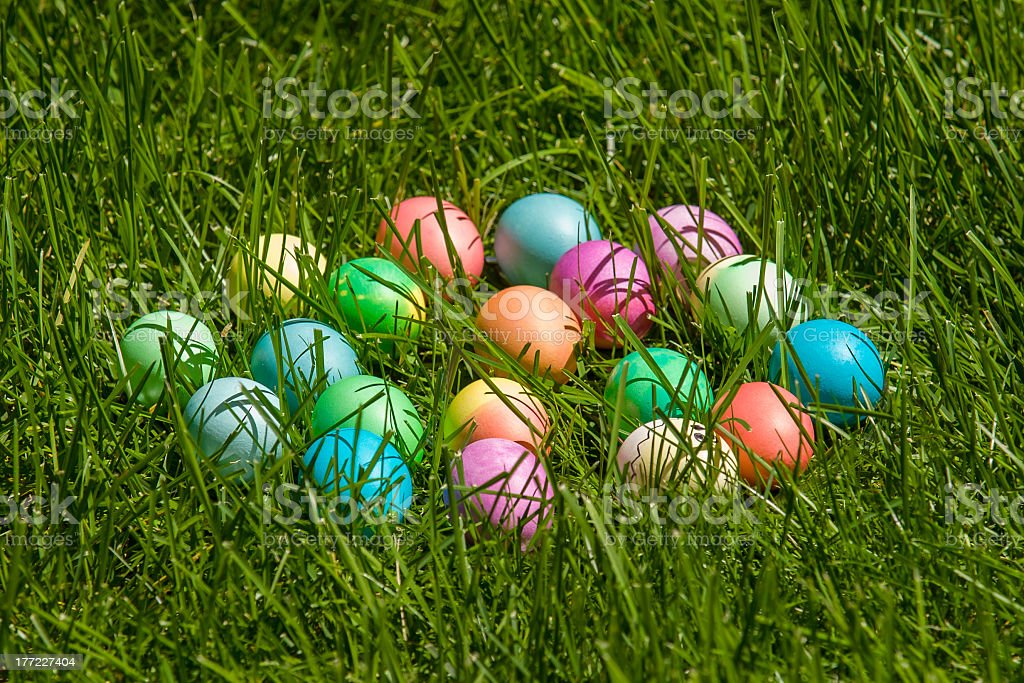 Colorful dyed Easter eggs in real grass royalty-free stock photo