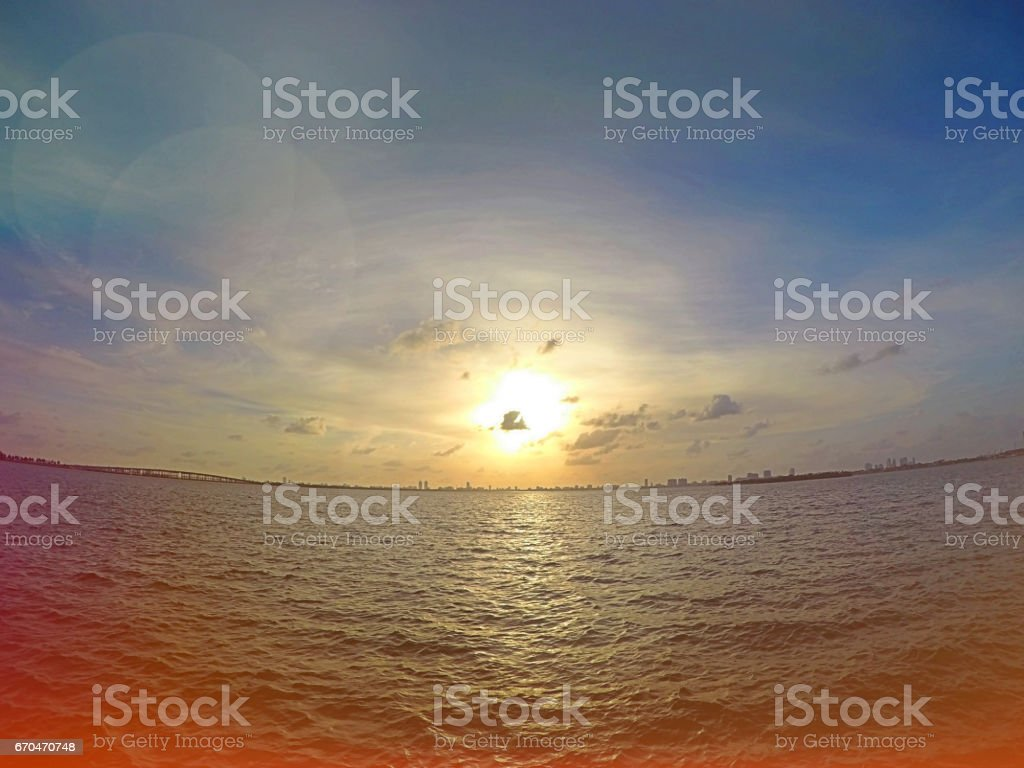 Colorful Filtered Image of Early Morning Sunrise and Blue Sky Taken...