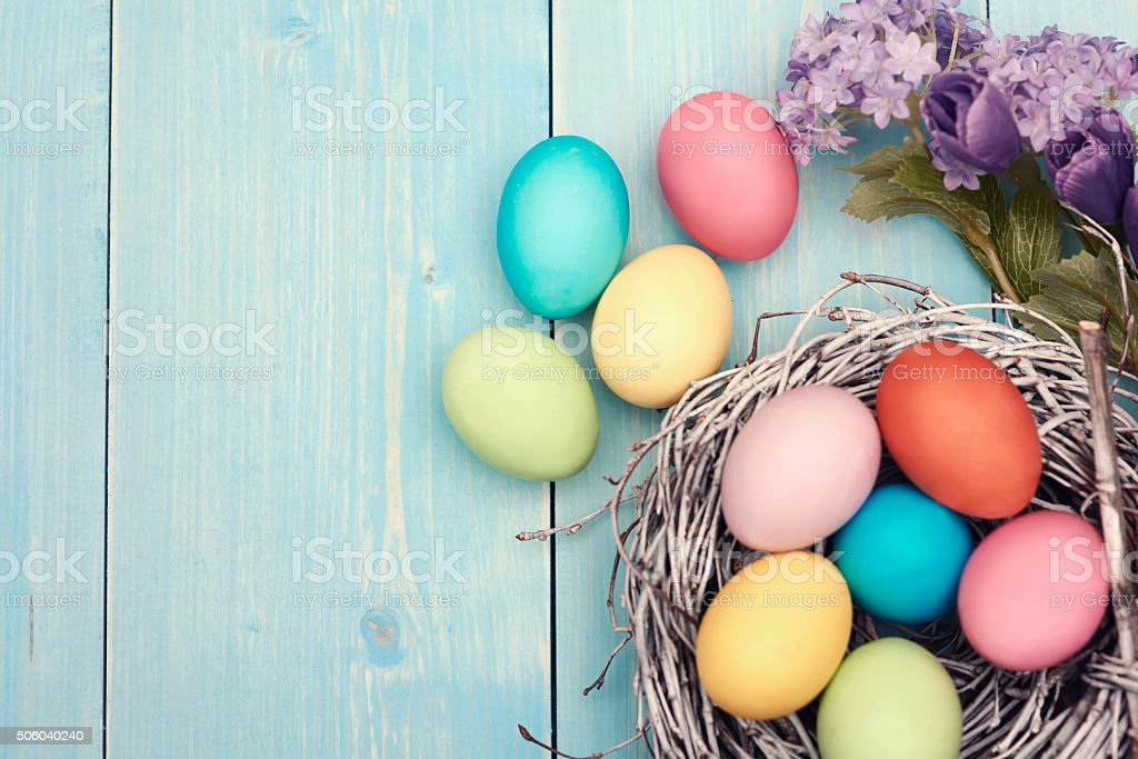 Colorful easter decarations on wooden plank stock photo