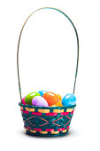 Colorful easter egg basket overflowing with easter eggs. Isolated on white background.