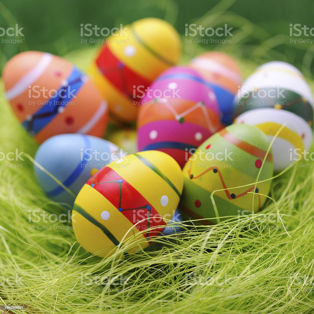 Colorful easter egg nest on green background royalty-free stock photo