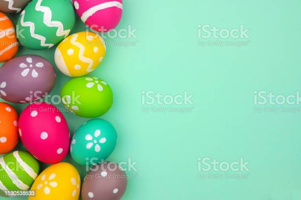 Colorful easter egg side border against a turquoise green background picture id1130538533?b=1&k=6&m=1130538533&s=612x612&h= ve fq2d7shzllef l993zzwxjd9ca1asshg1ndsoa4=