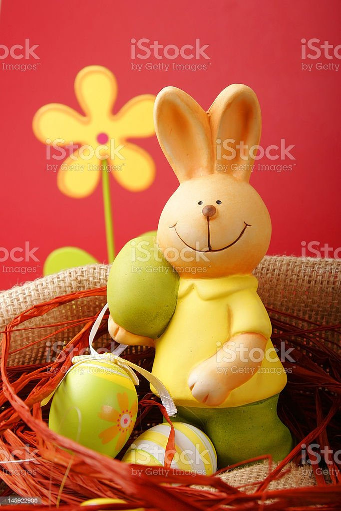 Colorful Easter eggs and a bunny with flower royalty-free stock photo