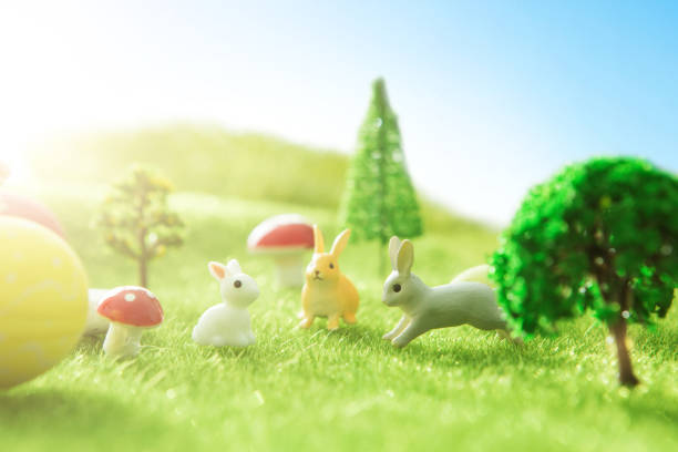 Colorful easter eggs and big yellow easter egg on spring green grass. stock photo