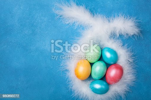 istock Colorful Easter eggs and bunny ears top view. Funny Easter greeting card. 930893272