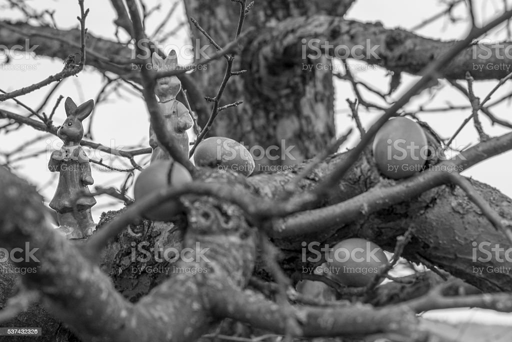 Colorful easter eggs and easter bunny on a tree stock photo