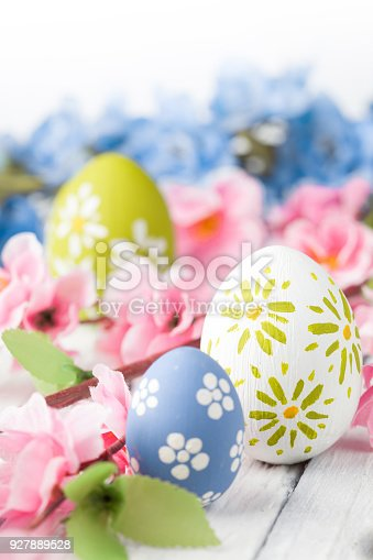 istock colorful easter eggs and flowers 927889528