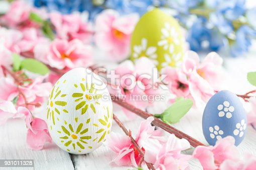 istock colorful easter eggs and flowers 931011328