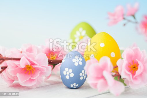 istock colorful easter eggs and flowers 931011398