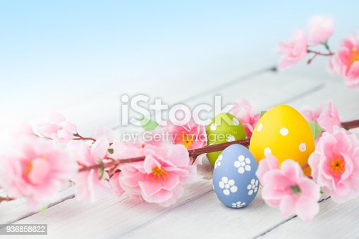istock colorful easter eggs and flowers 936858622