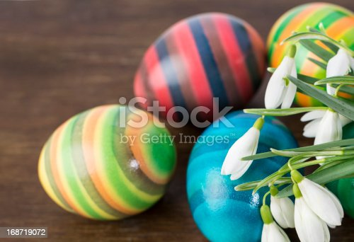 istock Colorful Easter eggs and snowdrops 168719072