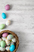 colorful easter eggs in wicker