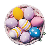 Colorful easter eggs in a plate isolated on white background, top view