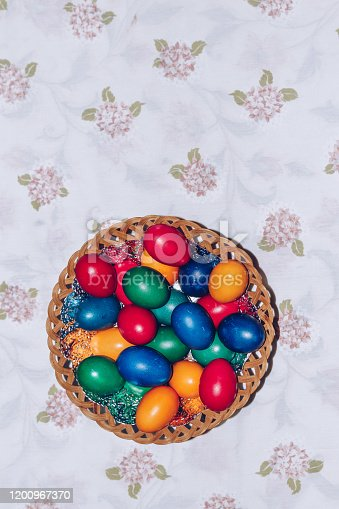 922661892 istock photo Colorful easter eggs in basket. Happy Easter, Christian religious holiday. 1200967370