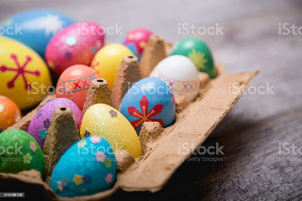 Colorful easter eggs in cardboard stock photo