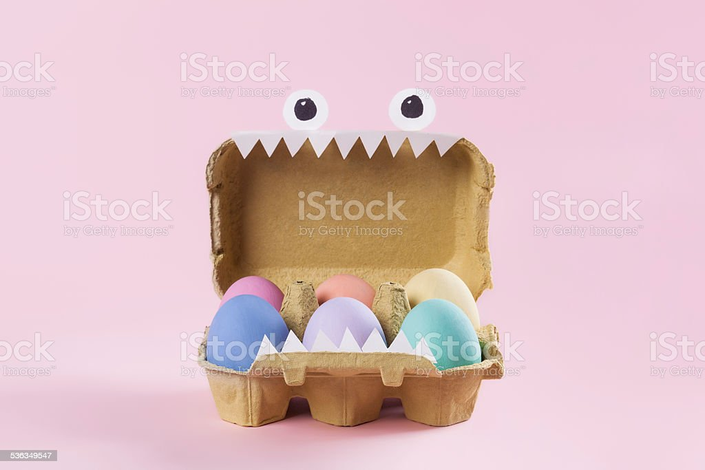 Colorful Easter eggs in monster egg carton