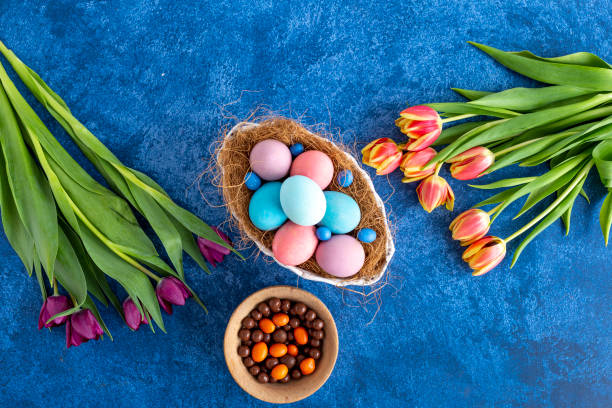 Colorful easter eggs in nest and tulips on deep blue background picture id1215093654?b=1&k=6&m=1215093654&s=612x612&w=0&h=qe6efjbjqfiej gaieio0e0q4odbsw6mxc0ke8frmi8=