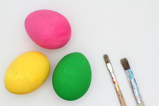colorful easter eggs isolated on white background. with paint brush.