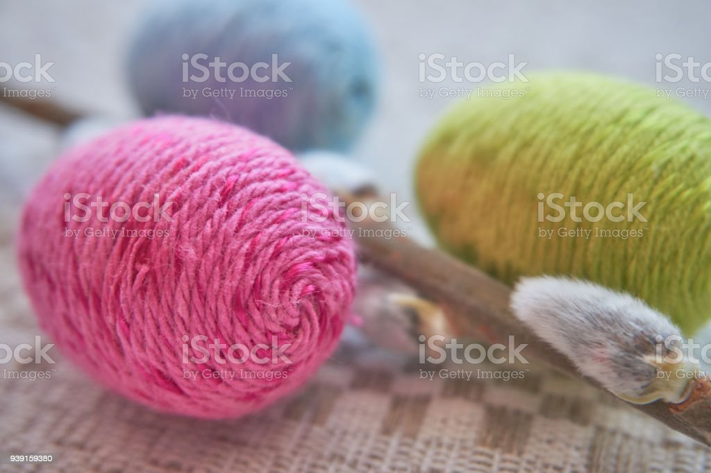 Colorful Easter Eggs On A Natural Patterned Linen Tablecloth