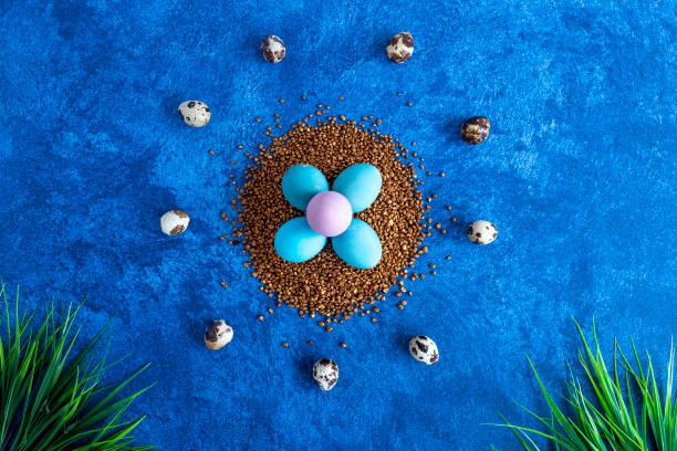 Colorful easter eggs on golden decorative rocks dark blue background picture id1215093607?b=1&k=6&m=1215093607&s=612x612&w=0&h=l3e9ypmgmko0zfxmciyheym7sym9jgld cjeag6bbns=