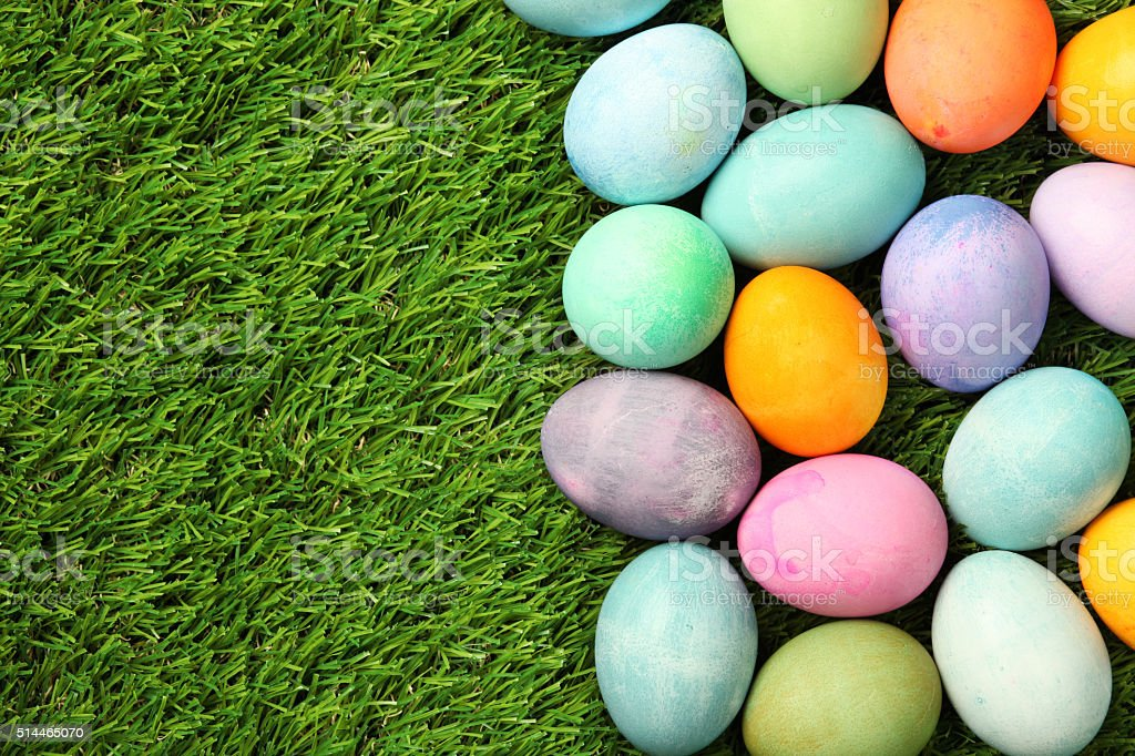 Colorful Easter eggs on grass background stock photo