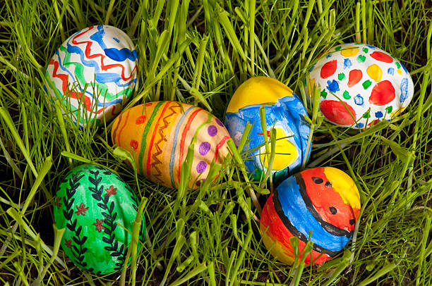 Colorful easter eggs on grass stock photo