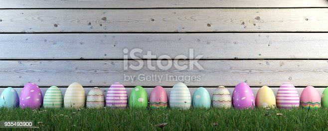 istock Colorful Easter Eggs On Grass 935493900