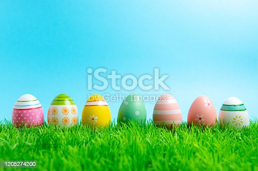 istock Colorful Easter eggs on green grass. Spring holidays concept. 1205274200