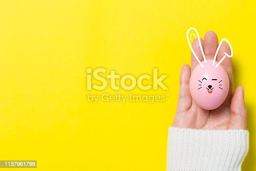 istock colorful easter eggs on yellow  background 1137961799