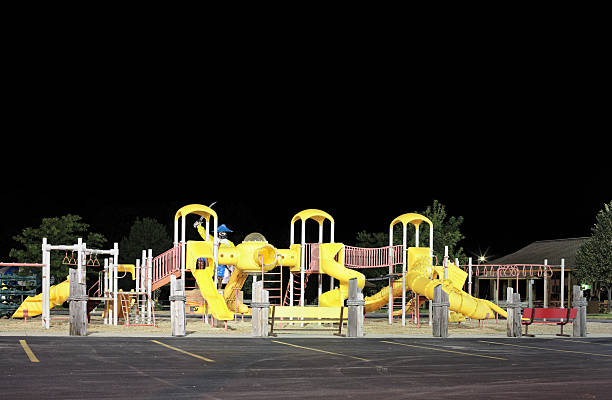 Colorful empty playground at night stock photo