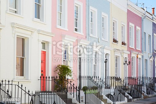 Colorful English houses facades in a row, pastel pale colors in London