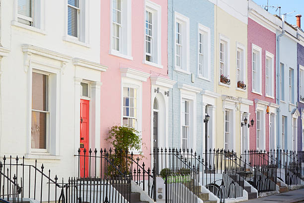 colorful english houses facades, pastel pale colors in london - color intensity stock pictures, royalty-free photos & images
