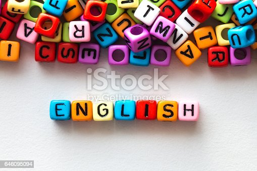 istock colorful english word cube on white paper background 646095094