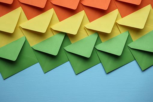 Colorful envelopes on blue background