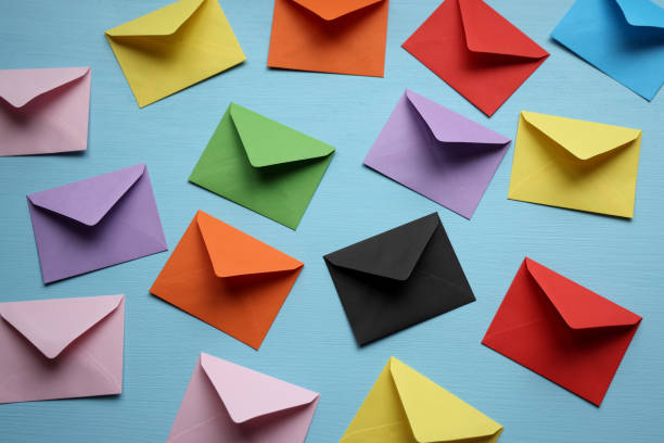 Colorful envelopes on blue background stock photo